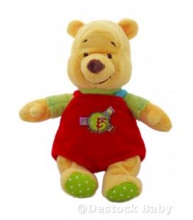 Peluche Doudou WINNIE Salopette rouge Etiquettes vert anis 24 cm Disney Baby Nicotoy