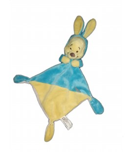 Doudou plat Winnie bleu jaune Capuche etiquette abeille Disney Nicotoy